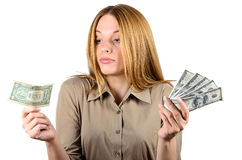Beautiful woman looking at a dollar Stock Image