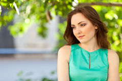 Beautiful woman looking down outdoors Royalty Free Stock Images