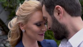 Beautiful woman looking into the eyes of her man. They bowed their heads to each other. stock video footage