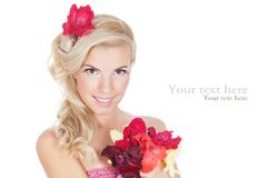 Beautiful woman looking at the flowers Royalty Free Stock Image