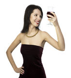 Beautiful woman looking through glass of wine Royalty Free Stock Images