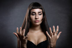 Beautiful woman looking at her hands Stock Photography