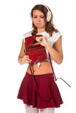Beautiful woman looking through her pocket book purse Stock Photo
