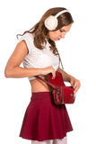 Beautiful woman looking through her pocket book purse Royalty Free Stock Images
