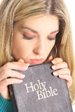 Beautiful woman looking at holy bible Royalty Free Stock Image