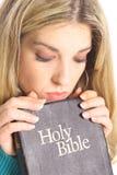 Beautiful woman looking at holy bible Royalty Free Stock Image