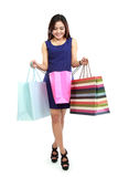 Beautiful woman looking inside her colourful shopping bags Royalty Free Stock Photography