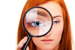 Beautiful woman looking through a magnifying glass Stock Photos