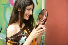 Beautiful woman looking in mirror Stock Photos