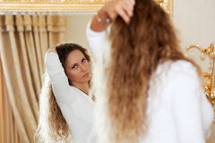 Beautiful woman looking in the mirror Stock Photo