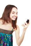Beautiful woman looking at mobile phone Royalty Free Stock Images