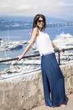 Beautiful woman looking at Monte Carlo harbour in Monaco. Azur coast. Royalty Free Stock Photography