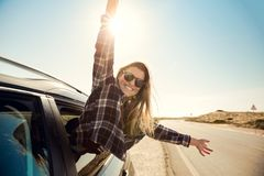 Happy girl looking out the car window royalty free stock images