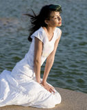 Beautiful  woman looking out at ocean a Royalty Free Stock Images