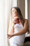 Beautiful woman looking out of the window Royalty Free Stock Photography