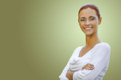 Beautiful woman looking over glasses Stock Image