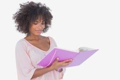 Beautiful woman looking at photo album Royalty Free Stock Photo
