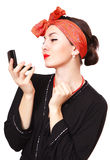 Beautiful woman looking in a pocket mirror Royalty Free Stock Photo