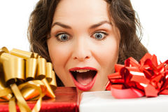 Beautiful woman looking at presents Stock Photo