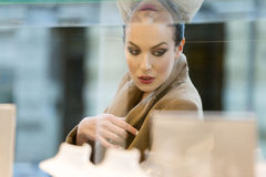Beautiful woman looking for sale on window shop Stock Image