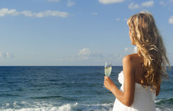 Beautiful woman looking at the sea Stock Photos