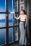 Beautiful Woman Looking at the Sea view Royalty Free Stock Photography