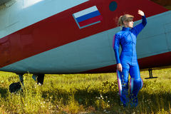 Beautiful woman looking at the sun with airplane Royalty Free Stock Photo
