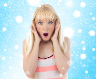 Beautiful woman looking surprise. Snowflakes Stock Photo