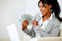 Beautiful woman looking to dollars Stock Photos
