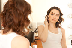 Woman looking to the mirror Royalty Free Stock Photo