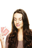 Beautiful woman looking to the poker cards in her Royalty Free Stock Photos