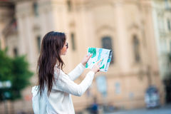 Beautiful woman looking at touristic citymap in Rome, Italy. Happy girl enjoy italian vacation holiday in Europe. Young beautiful girl with city map in Europe Royalty Free Stock Photo