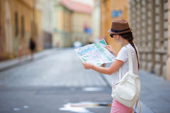 Beautiful woman looking at touristic citymap in Rome, Italy. Happy girl enjoy italian vacation holiday in Europe. Young beautiful girl with city map in Europe Royalty Free Stock Image