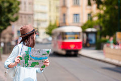Beautiful woman looking at touristic citymap in Rome, Italy. Happy girl enjoy italian vacation holiday in Europe. Young beautiful girl with city map in Europe Stock Photo