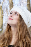 Beautiful woman looking up. Young beautiful woman looking up on a winter day outdoors Stock Images