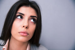 Beautiful woman looking up. Closeup portrait of a beautiful woman looking up Stock Photos