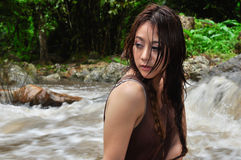 Beautiful woman looking at waterfall Stock Images