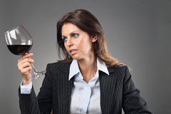 Beautiful woman looking at wineglass Royalty Free Stock Image