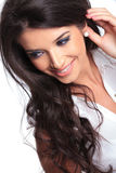 Beautiful woman looks down and smiles Royalty Free Stock Image