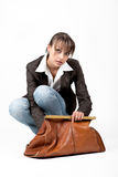 Beautiful woman looks into her bag Royalty Free Stock Image