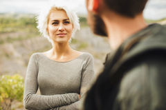 Beautiful woman looks at man Royalty Free Stock Image