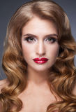 Beautiful woman looks softly and fascinating Royalty Free Stock Photo