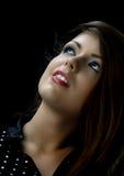 Beautiful woman looks upwards Stock Photo