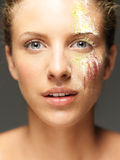 Beautiful woman loose colored powders on face Royalty Free Stock Photography