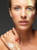 Beautiful woman loose colored powders on face Stock Photos