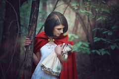 Beautiful woman lost in the wood Stock Image