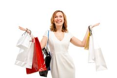 Beautiful woman with a lot of shopping bags Royalty Free Stock Image