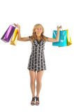Beautiful woman with a lot of shopping bags. isolated on white Royalty Free Stock Images
