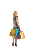 Beautiful woman with a lot of shopping bags. isolated on white Royalty Free Stock Photo