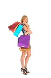 Beautiful woman with a lot of shopping bags. isolated on white Stock Image